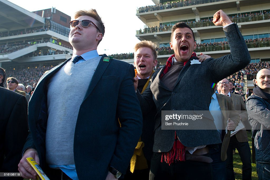 Racegoers celebrate after Thistlecrack wins the Ryanair World Hurdle during St Patrick's Day at the Cheltenham Festival at Cheltenham Racecourse on March 17, 2016 in Cheltenham, England. The four day annual jump racing event sees jockeys compete for a piece of the 4.1 million GBP of the prize money.