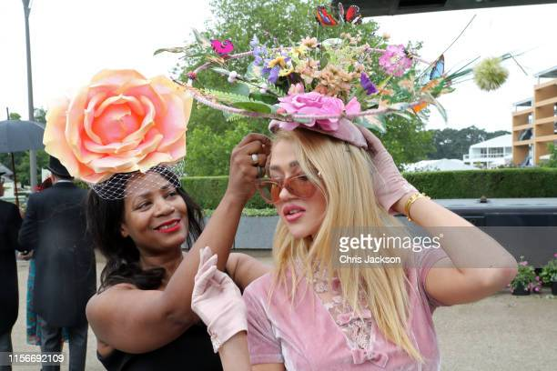 Racegoers check their hats on day one of Royal Ascot at Ascot Racecourse on June 18, 2019 in Ascot, England.