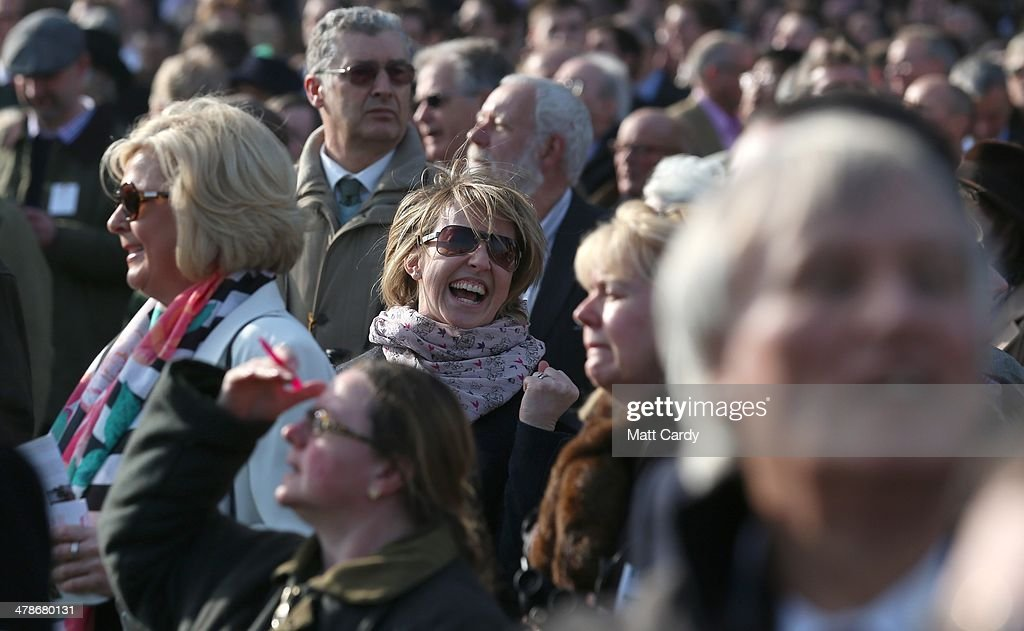 Racegoers cheer as they celebrate a win in the third race of the day on the final day of the Cheltenham Festival on March 14, 2014 in Cheltenham, England. Thousands of racing enthusiasts have been at the four-day festival, which ends today with the festival's Gold Cup and is seen as many as the highlight of the jump racing calendar.
