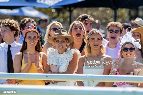 Racegoers cheer as they watch the Melbourne Cup on the big screen during Bentley Cup Day at Royal Randwick Racecourse on November 03, 2020 in Sydney,...