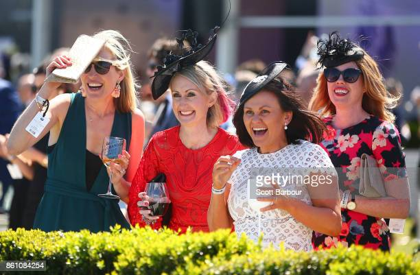 Racegoers cheer during a race during Melbourne Racing on Caulfield Guineas Day at Caulfield Racecourse on October 14 2017 in Melbourne Australia