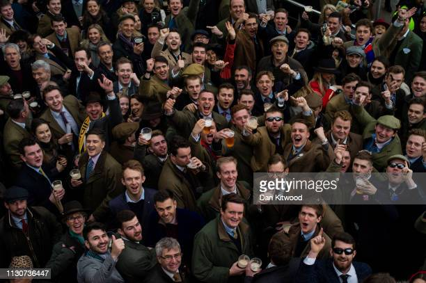 Racegoers cheer during the Cheltenham Festival at Cheltenham Racecourse on March 15 2019 in Cheltenham England