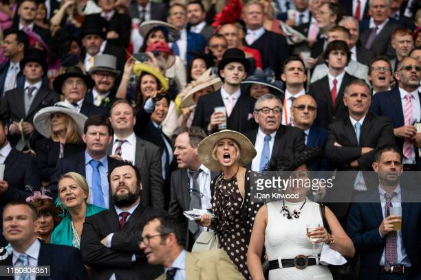 Racegoers cheer during the final race of the first day at Ascot Racecourse on June 18 2019 in Ascot England The fiveday meeting is one of the...