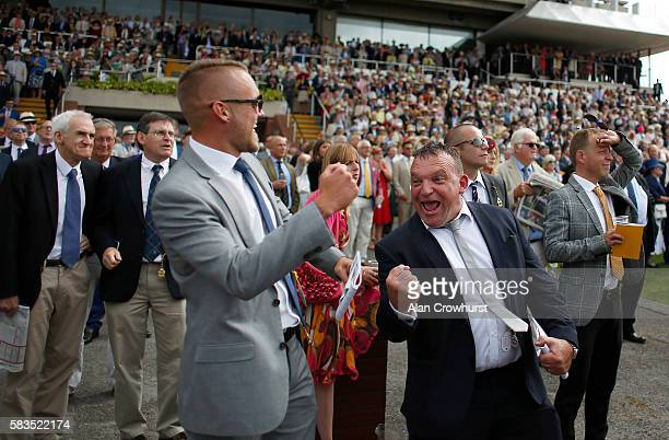 Racegoers cheer home a winner at Goodwood on July 26 2016 in Chichester England