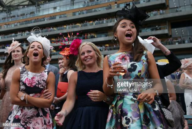 Racegoers cheer on their horse on Ladies Day at the Royal Ascot horse racing meet, in Ascot, west of London, on June 22, 2017. The five-day meeting...