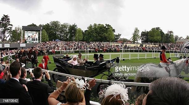 Racegoers clap as HRH Queen Elizabeth II arrives in the Parade Ring at Royal Ascot on June 23 2007 in Ascot England