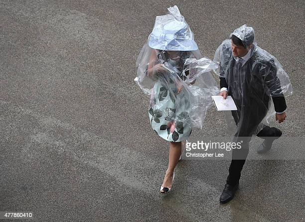 Racegoers cover themselvesfrom the rain with poncho's during Day 5 of Royal Ascot at Ascot Racecourse on June 20 2015 in Ascot England