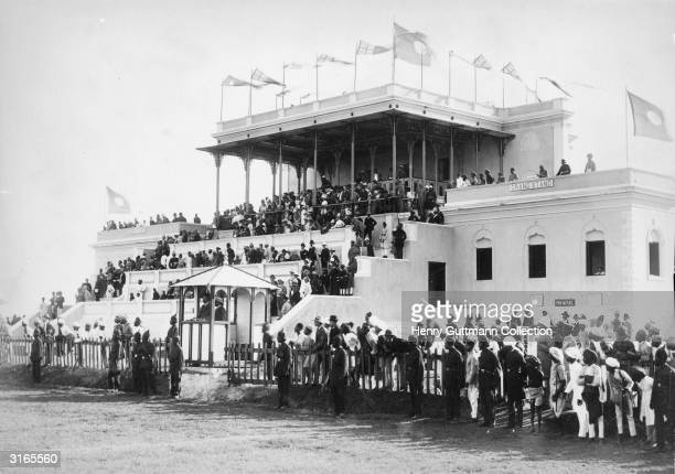 Racegoers crowded in to the grandstand of Hyderabad racecourse during the days of the British Raj