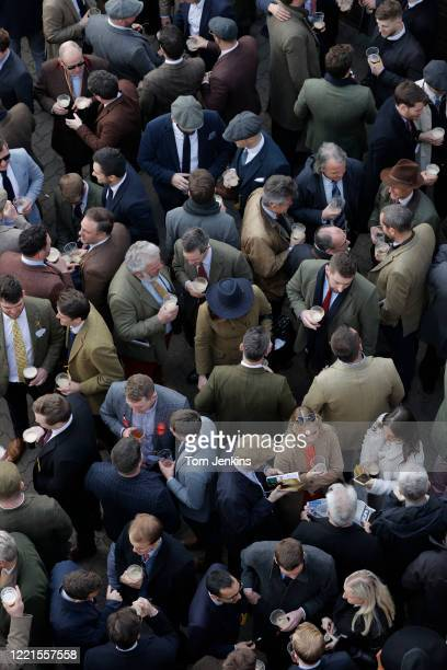 Racegoers crowded into a bar before racing during day four of the Cheltenham National Hunt Racing Festival at Cheltenham Racecourse on March 13th...