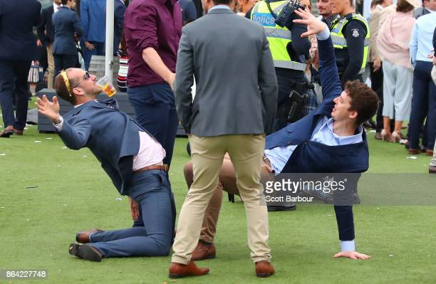 Racegoers dance during Caulfield Cup Day at Caulfield Racecourse on October 21 2017 in Melbourne Australia