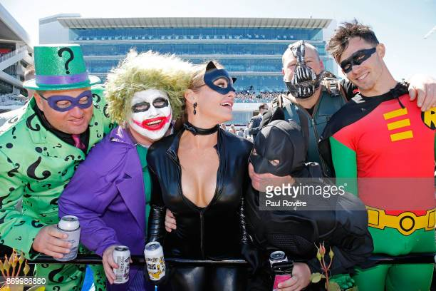 Racegoers dressed as superheroes and villains enjoy the perfect weather on Derby Day at Flemington Racecourse on November 4 2017 in Melbourne...