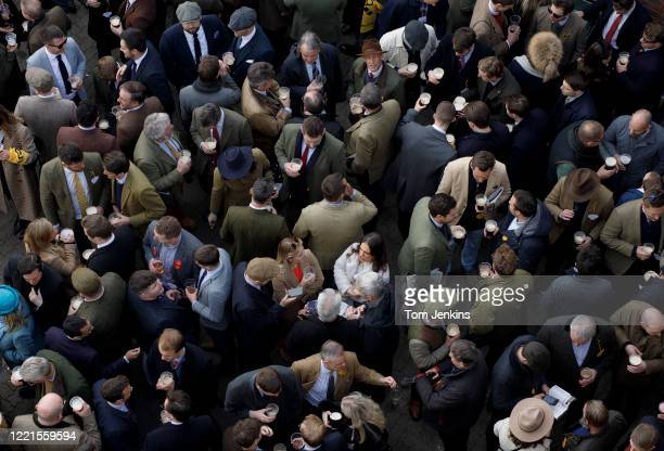 Racegoers drinking in the Arkle Bar before racing during day four of the Cheltenham National Hunt Racing Festival at Cheltenham Racecourse on March...