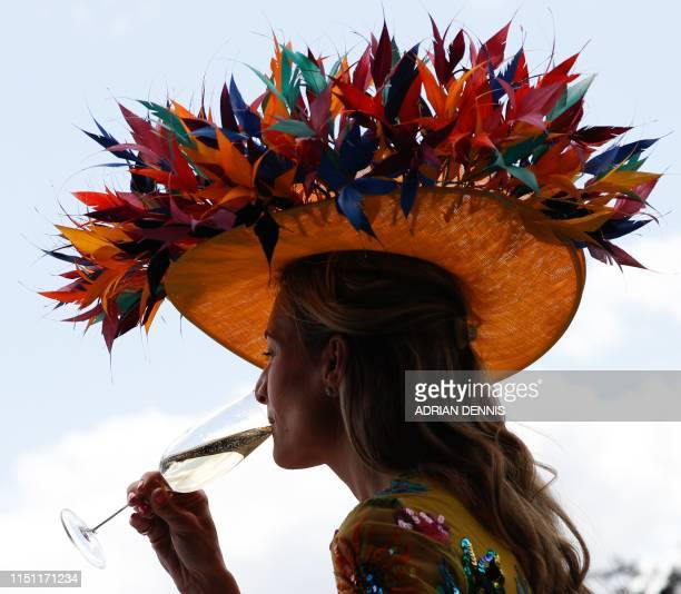 Racegoers enjoy a drink as they attend day four of the Royal Ascot horse racing meet in Ascot west of London on June 21 2019 The fiveday meeting is...