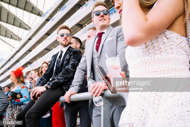 Racegoers enjoy a drink during day four of Royal Ascot at Ascot Racecourse on June 21, 2019 in Ascot, England.