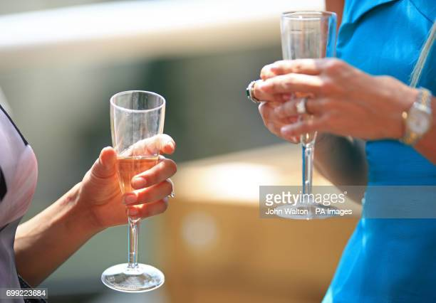 Racegoers enjoy a glass of Champagne during day two of Royal Ascot at Ascot Racecourse
