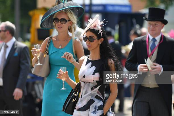 Racegoers enjoy a glass of champagne on Day Two of Royal Ascot at Ascot Racecourse on June 21 2017 in Ascot England
