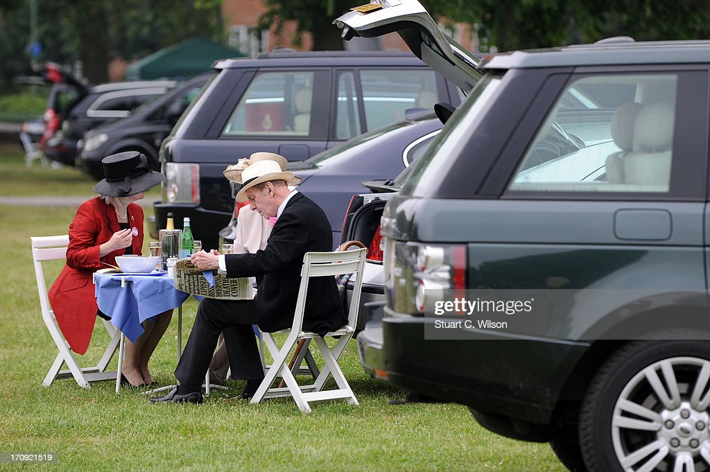 Racegoers enjoy a picnic on Ladies' Day on day three of Royal Ascot at Ascot Racecourse on June 20, 2013 in Ascot, England.