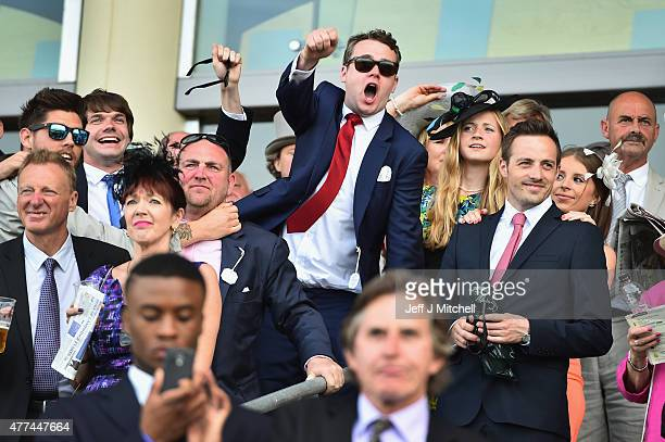 Racegoers enjoy Day Two at the Royal Ascot Racecourse on June 17 2015 in London England The Royal Ascot horse race meeting runs from June 16 to June...