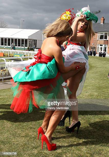 Racegoers enjoy Ladies Day at Aintree on April 5 2013 in Liverpool England