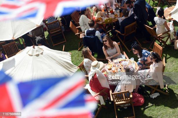 Racegoers enjoy refreshments trackside within the Queen Anne Enclosure on day 5 of Royal Ascot at Ascot Racecourse on June 22, 2019 in Ascot, England.