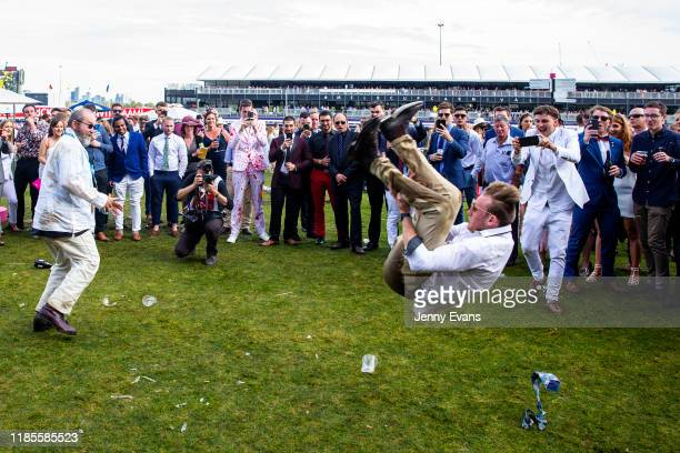 Race-goers enjoy the atmosphere after the 2019 Melbourne Cup Day at Flemington Racecourse on November 05, 2019 in Melbourne, Australia.