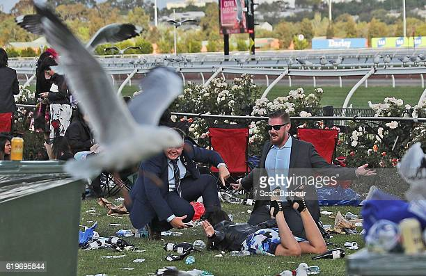Racegoers enjoy the atmosphere following 2016 Melbourne Cup Day at Flemington Racecourse on November 1 2016 in Melbourne Australia