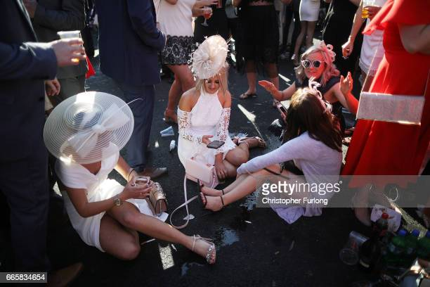 Racegoers enjoy the atmosphere of Ladies Day at the Randox Health Grand National Festival at Aintree Racecourse on April 6 2017 in Liverpool England...