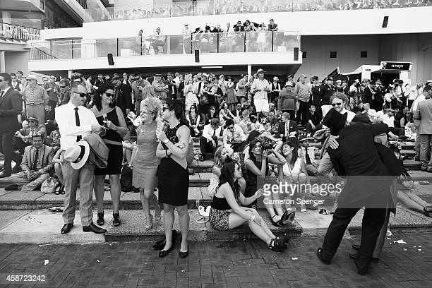 Racegoers enjoy the atmosphere on Melbourne Cup Day at Flemington Racecourse on November 4 2014 in Melbourne Australia