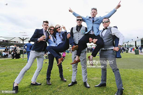 Racegoers enjoy the atmosphere on Melbourne Cup Day at Flemington Racecourse on November 1 2016 in Melbourne Australia