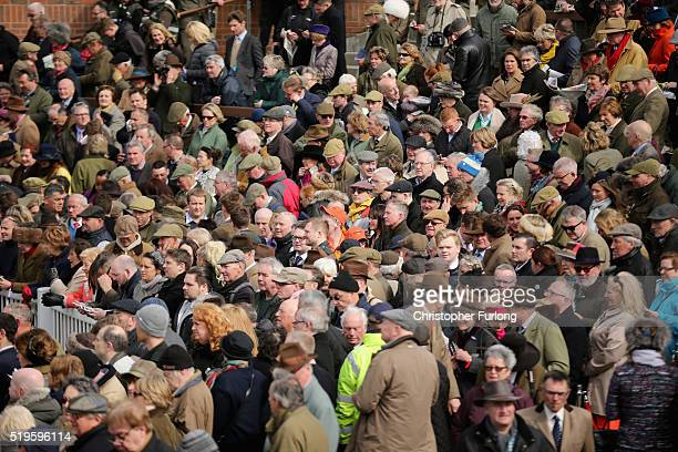 Racegoers enjoy the atmosphere on the first day of the Aintree Grand National Festival meeting on April 7 2016 in Aintree England Today is the first...