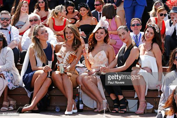 Racegoers enjoy the fashions colour and atmosphere on Kennedy Oaks Day at Flemington Racecourse on November 9 2017 in Melbourne Australia A crowd of...