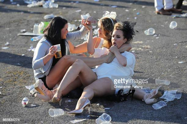 Racegoers enjoy the party atmosphere of Ladies Day at the Randox Health Grand National Festival at Aintree Racecourse on April 6, 2017 in Liverpool,...