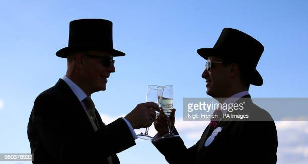 Racegoers enjoying a drink during day three of Royal Ascot at Ascot Racecourse.