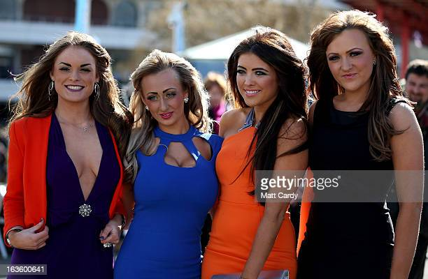 Racegoers Fawn Beddows Katie Morley Fay Watson and Ashley Rees pose for a photograph as they arrive for Ladies Day at Cheltenham Racecourse on the...
