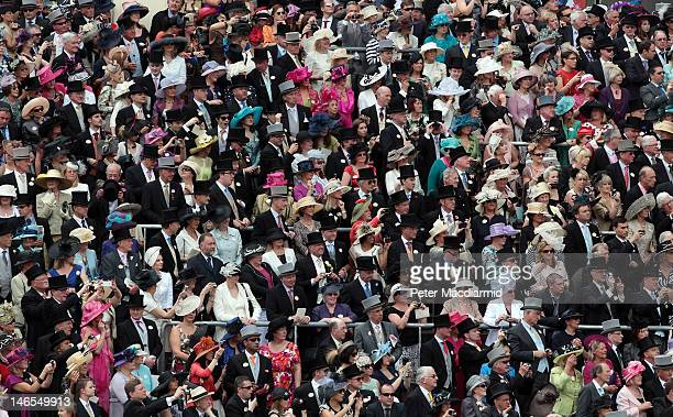 Racegoers from The Royal Enclosure watch the arrival of the Royal family at Royal Ascot on June 19 2012 in Ascot England The fiveday meeting is one...