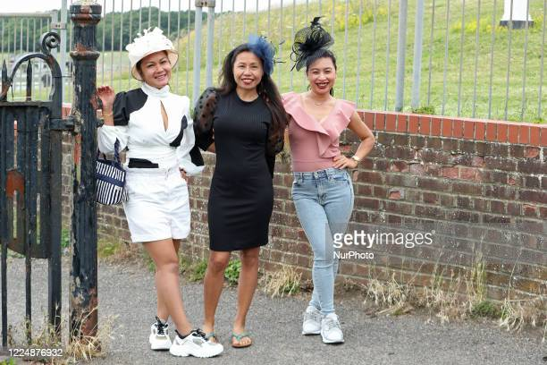 Racegoers gather on Epsom Downs south of London on July 4 2020 to witness the 241st Epsom Derby which was postponed on June 6th and was contested by...