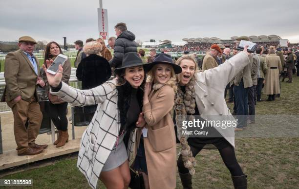 Racegoers gather to watch the first raced of the day on Ladies Day at the Cheltenham Racecourse on March 14 2018 in Cheltenham England Thousands of...