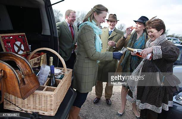 Racegoers have a picnic in the car park on the first day of the Cheltenham Festival on March 11 2014 in Cheltenham England Thousands of racing...