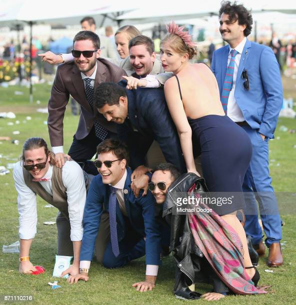 Racegoers have fun after the last race during Melbourne Cup Day at Flemington Racecourse on November 7 2017 in Melbourne Australia