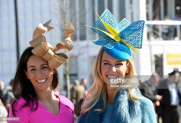 Racegoers in fashionable hats attend Ladies Day at Cheltenham Festival on March 15 2017 in Cheltenham England