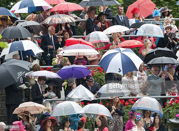 Racegoers In The Rain On The Third Day Of Royal Ascot.