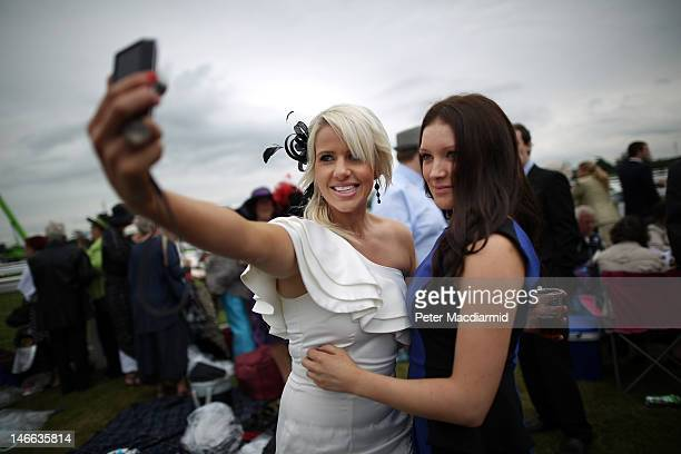 Racegoers in the Silver Ring take a phone photo during a race at Royal Ascot on Ladies Day on June 21 2012 in Ascot England Ladies Day is...