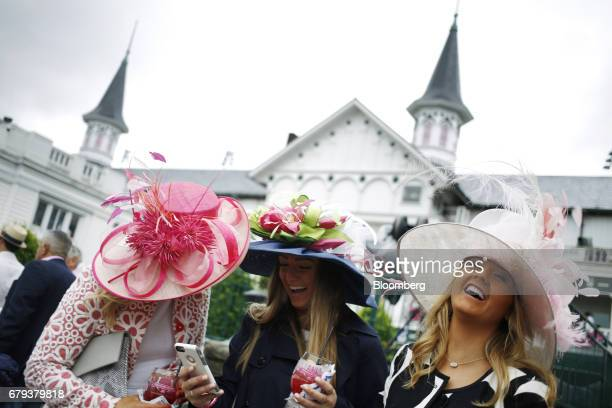 Racegoers laugh after taking a selfie on the eve of the Kentucky Derby at Churchill Downs in Louisville, Kentucky, U.S., on Friday, May 5, 2017. The...