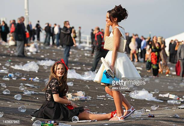 Racegoers leave Aintree Racecourse after Ladies' Day at Aintree Racecourse on April 13 2012 in Liverpool England