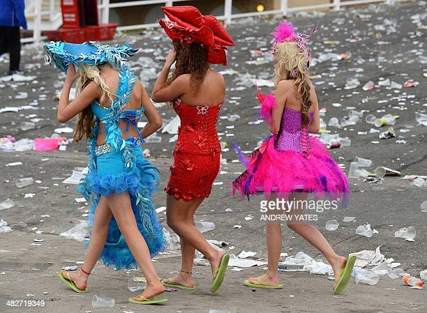 Racegoers leave the course at the end of Ladies Day of the Grand National horse race meeting at Aintree in Liverpool northwest England on April 4...