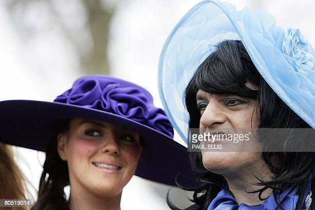Racegoers line up to take part in the best dressed racegoer competition on ladies day on the second day of the Grand National meeting at Aintree...