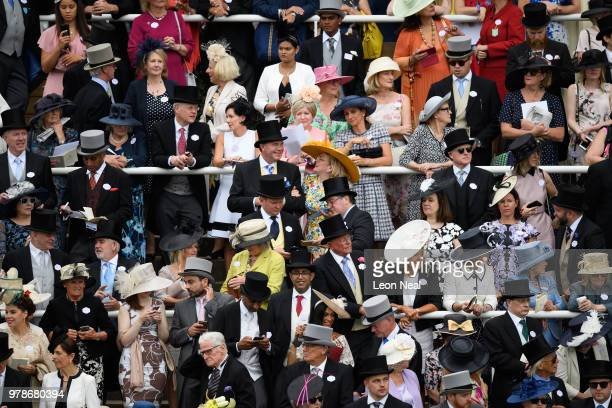 Racegoers look on as Britain's Queen Elizabeth II attends Royal Ascot Day 1 at Ascot Racecourse on June 19 2018 in Ascot United Kingdom Royal Ascot...