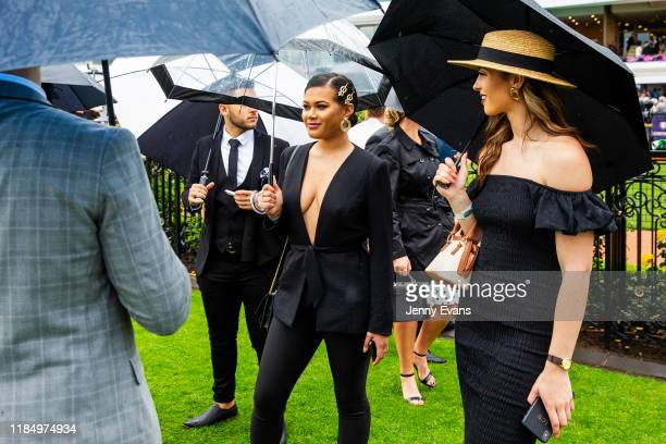 Race-goers look on during 2019 Derby Day at Flemington Racecourse on November 2, 2019 in Melbourne, Australia.