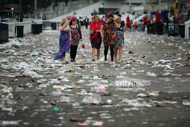 Racegoers make their way home after Ladies Day on the second day of the Grand National meeting at Aintree Racecourse on April 9 2010 in Aintree...