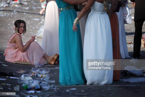 Racegoers make their way home at the end of Ladies Day of the Aintree Grand National meeting on April 8 2011 in Aintree England Friday is...